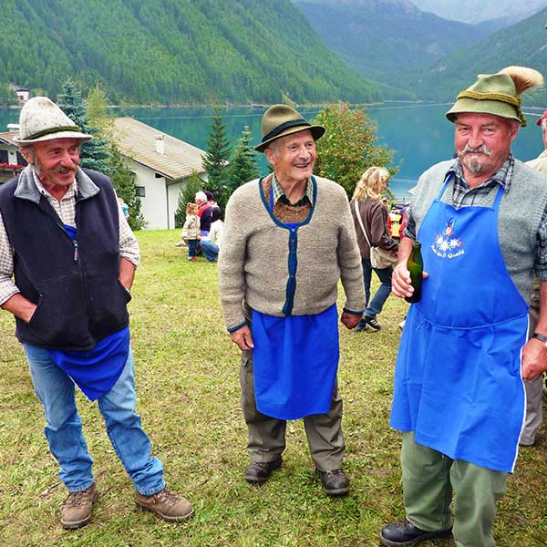 Proud of their typical herdsmen's aprons - Sheep drive Vent, Ötztal, Tyrol